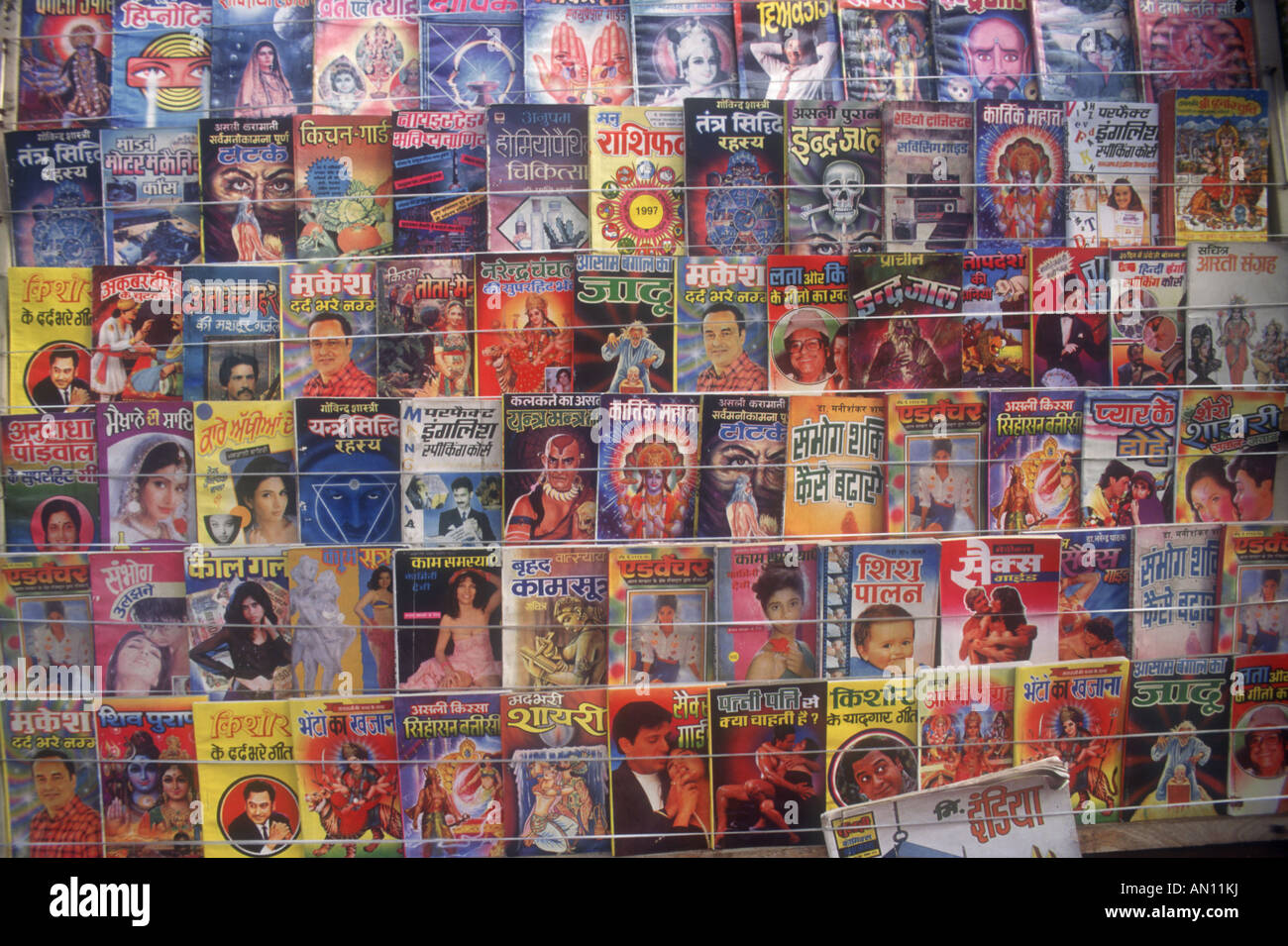 Close-up of comics displayed on road side comic stall. India - Stock Image