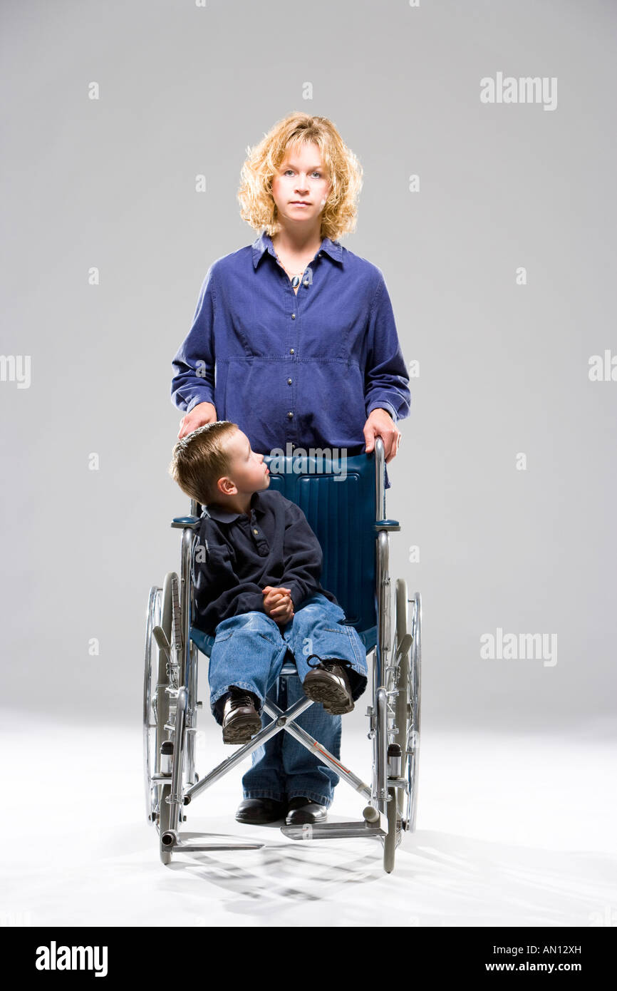 Mother and child in wheelchair - Stock Image