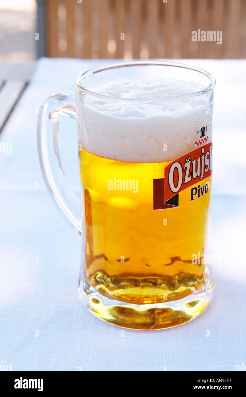 a big glass of refreshing cool beer pivo with white froth hotel