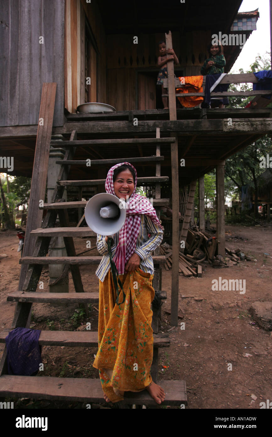 Community leader Ms Mat Ro, with a loud hailer donated by Oxfam in the villiage of Loveathon, Cambodia. - Stock Image
