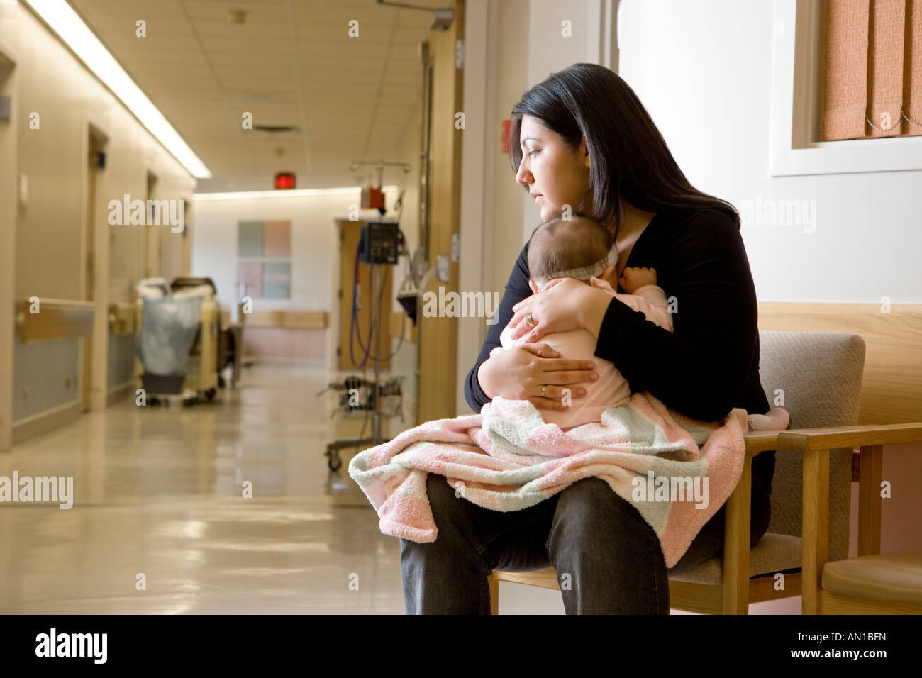 Young woman with baby in the hospital - Stock Image