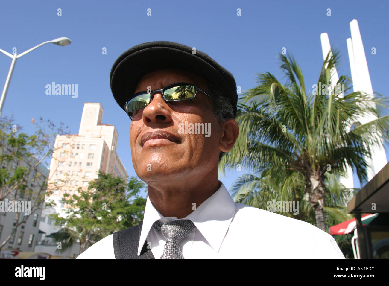 ff34a131be9 Miami Beach Florida Asian man sunglasses waits for public bus Stock ...