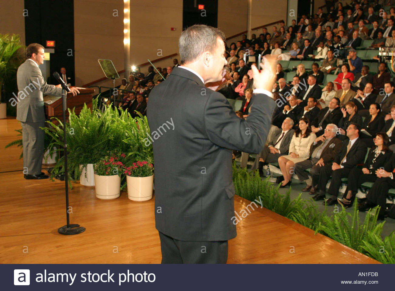 Coral Gables Miami Florida University of Miami Gusman Hall annual State of the County Address man translates speech into sign language - Stock Image