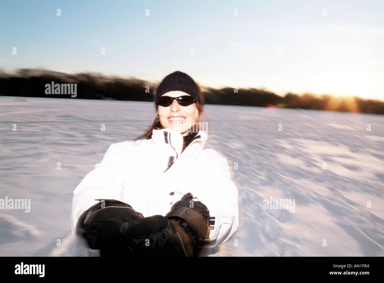 young woman enjoying snow in hamburg - Germany, fun, snowy, Lifestyle - Stock Image