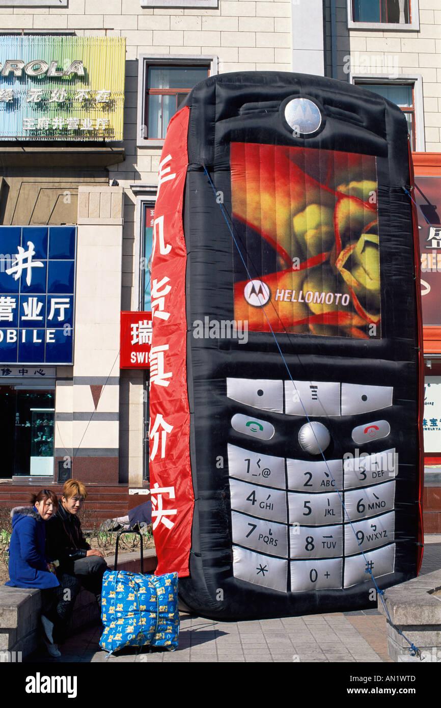 China, Beijing, Street Scene, Mobile Phone Promotional Advertising - Stock Image