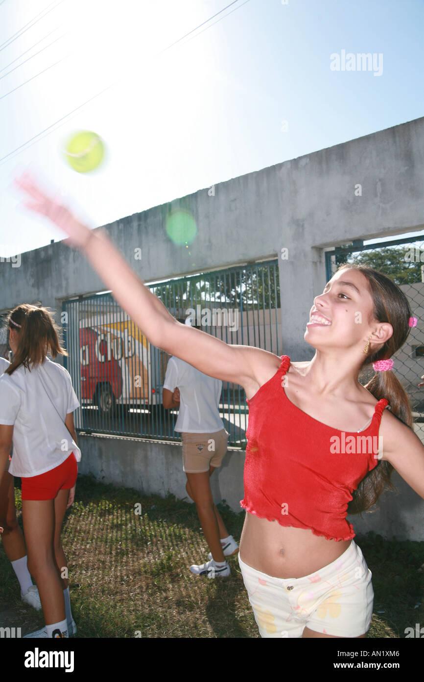 Cuba Cienfuegos female pupils playing a version of baseball - Stock Image