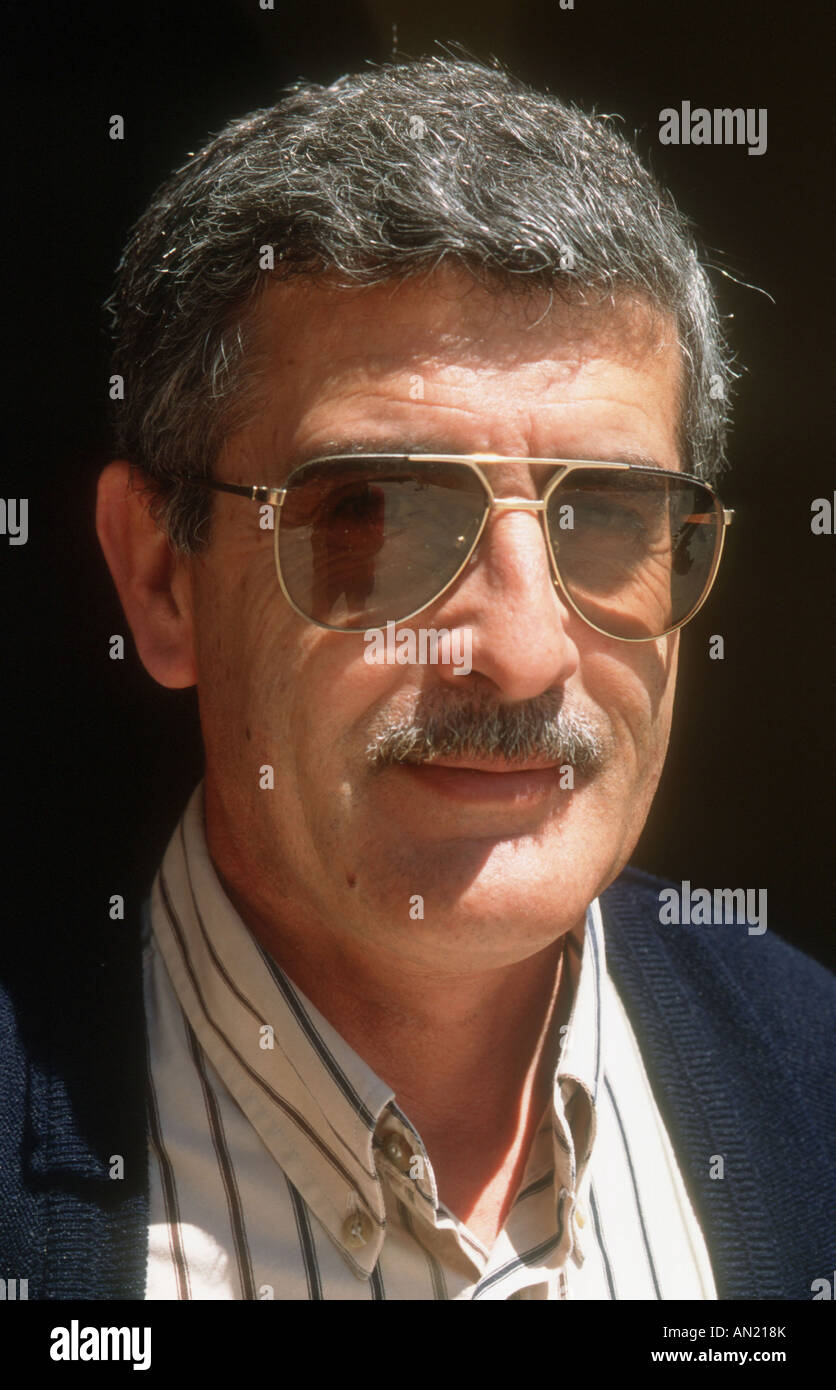 Portrait of man with moustache wearing sunglasses. Spain - Stock Image