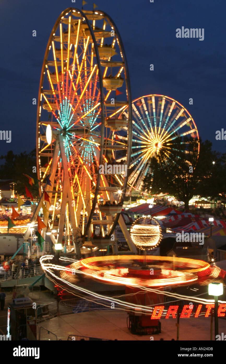 North Carolina, South, Tar Heel State, Wake County, Raleigh, North Carolina State Fair, Ferris Wheels, carnival Stock Photo