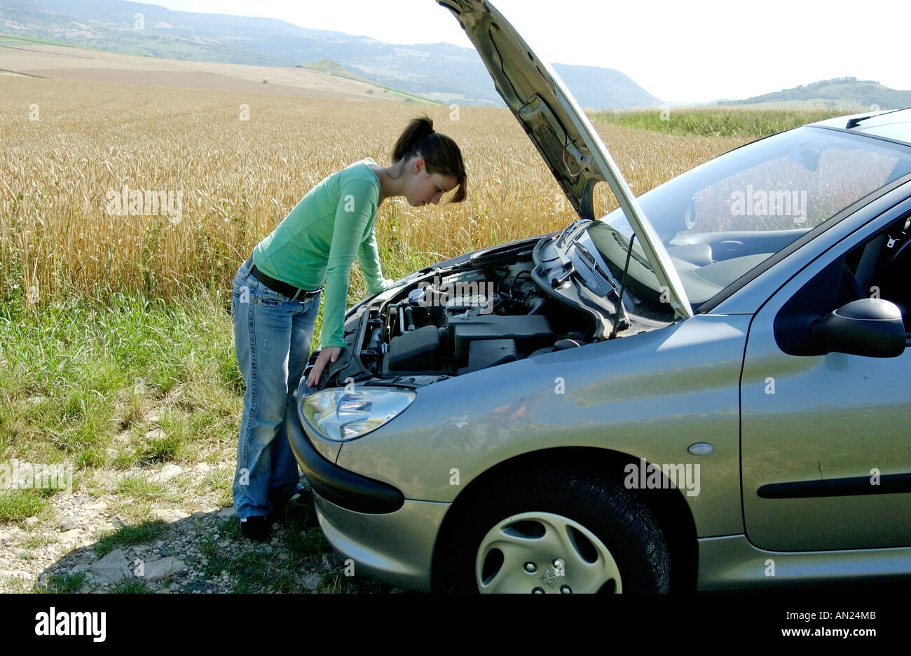 Young driver with a broken down car Stock Photo