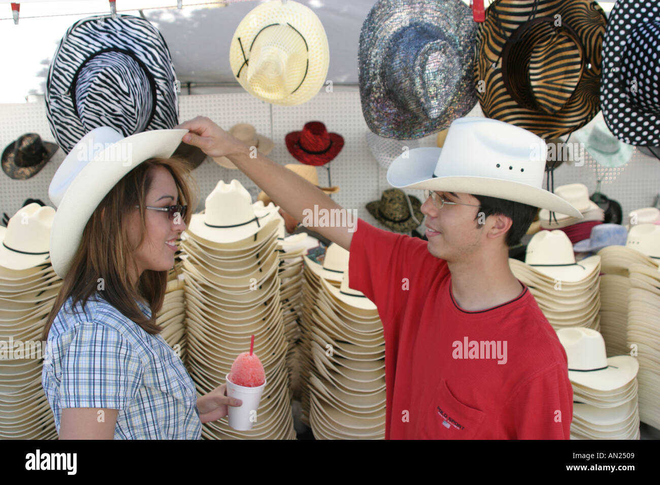 6540b50c59c Albuquerque New Mexico State Fair Asians try cowboy hats Stock Photo ...