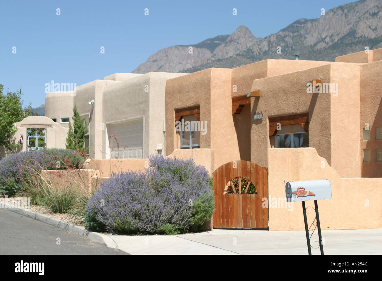 Albuquerque To Santa Fe >> Albuquerque New Mexico Sandia Heights adobe style homes high desert T Stock Photo: 1385803 - Alamy