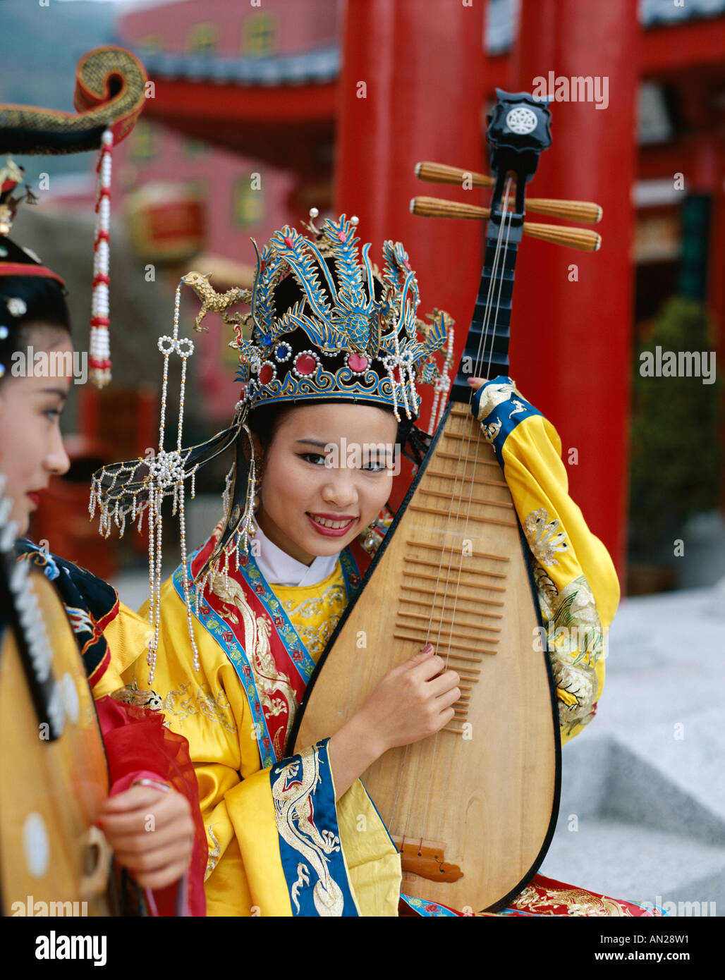 Women Dressed in Traditional Costume Playing Three Stringed Lute, Beijing  , China - Stock Image