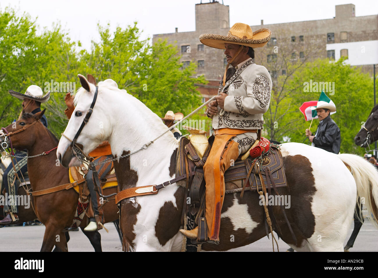 ILLINOIS Chicago Man in native Mexican costume ride horse in Ciinco de Mayo parade & ILLINOIS Chicago Man in native Mexican costume ride horse in Ciinco ...
