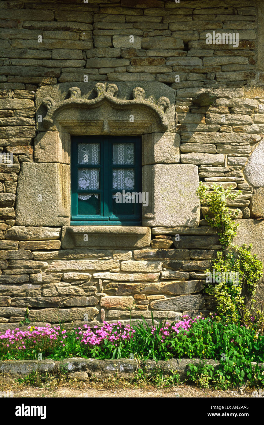 Detail of window in sixteenth century stone cottage in Brittany France - Stock Image