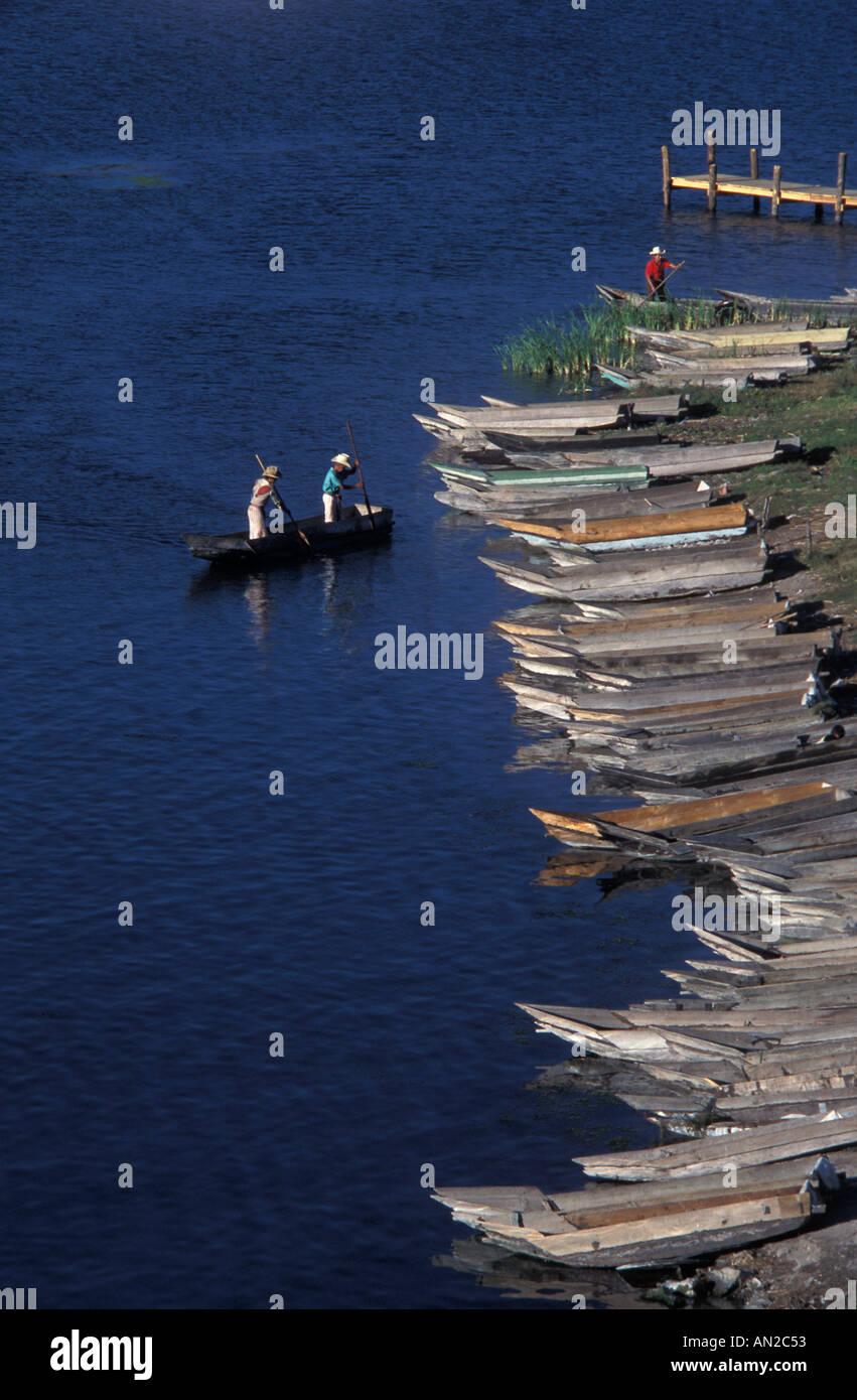 Fishermen in canoes heading for shore Santiago Atitlan Lake Atitlan Guatemala - Stock Image