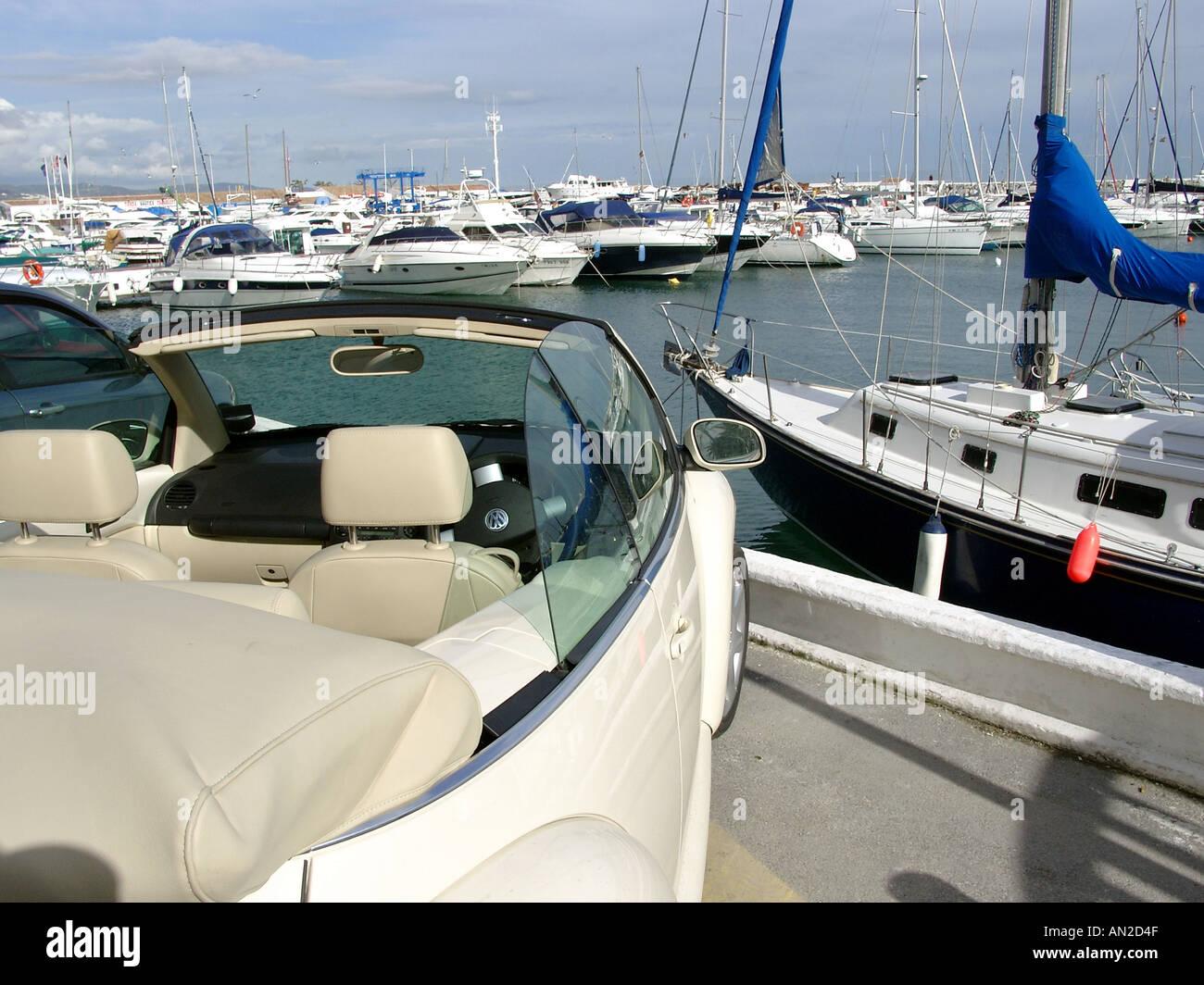Volkswagen Beetle Convertible car and boats Puerto Banus Costa del Sol Spain - Stock Image