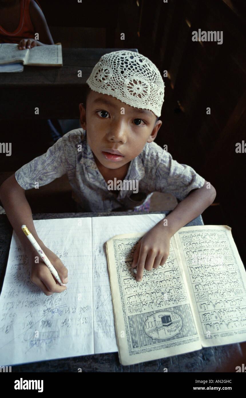 Muslim School Boy Studying the Koran, Kota Bharu, Kelantan, Malaysia - Stock Image