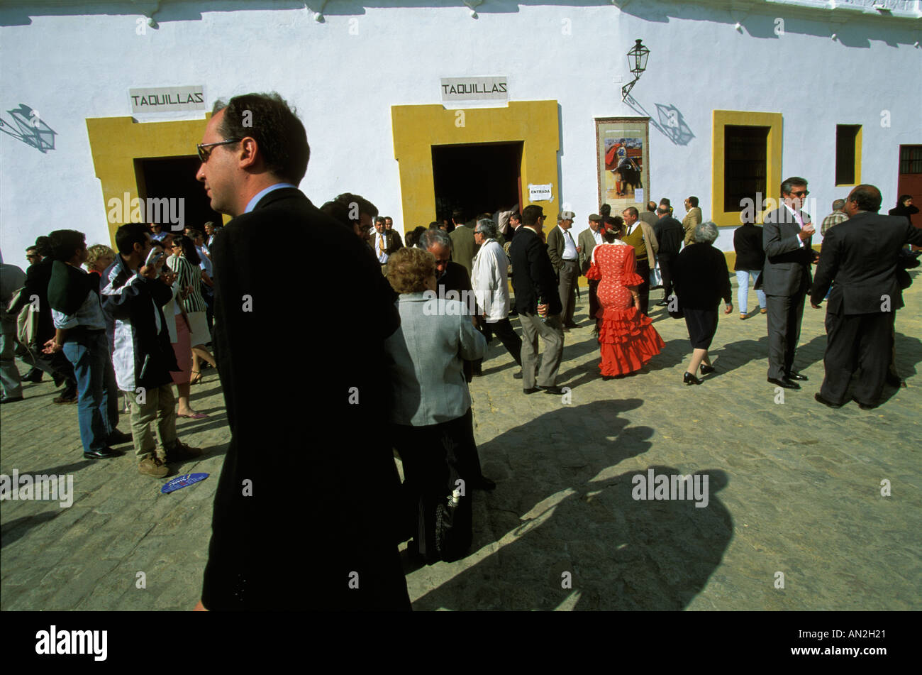 Spectators on their way to a bullfight on the Maestranza Bullring during the April Fair of Seville Andalucia Spain Stock Photo