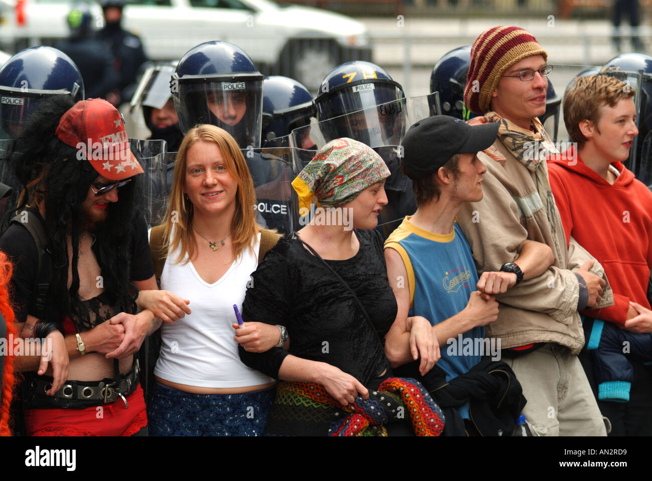 Protesters holding a line against riot police on South St David Street, Edinburgh, Scotland, UK - Stock Image