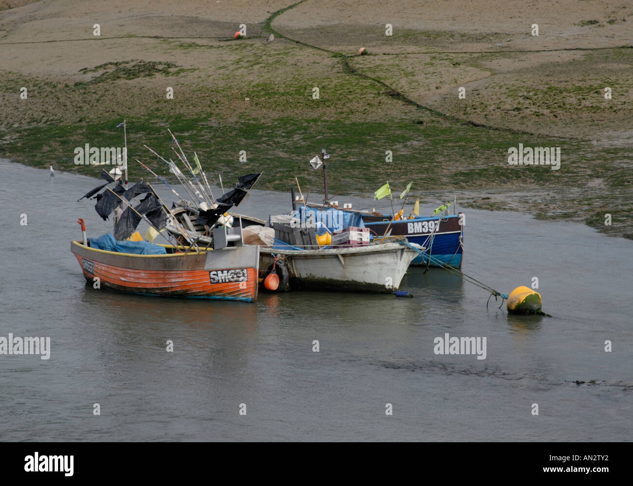 Small fishing boats moored in the estuary of the River Adur Stock Photo