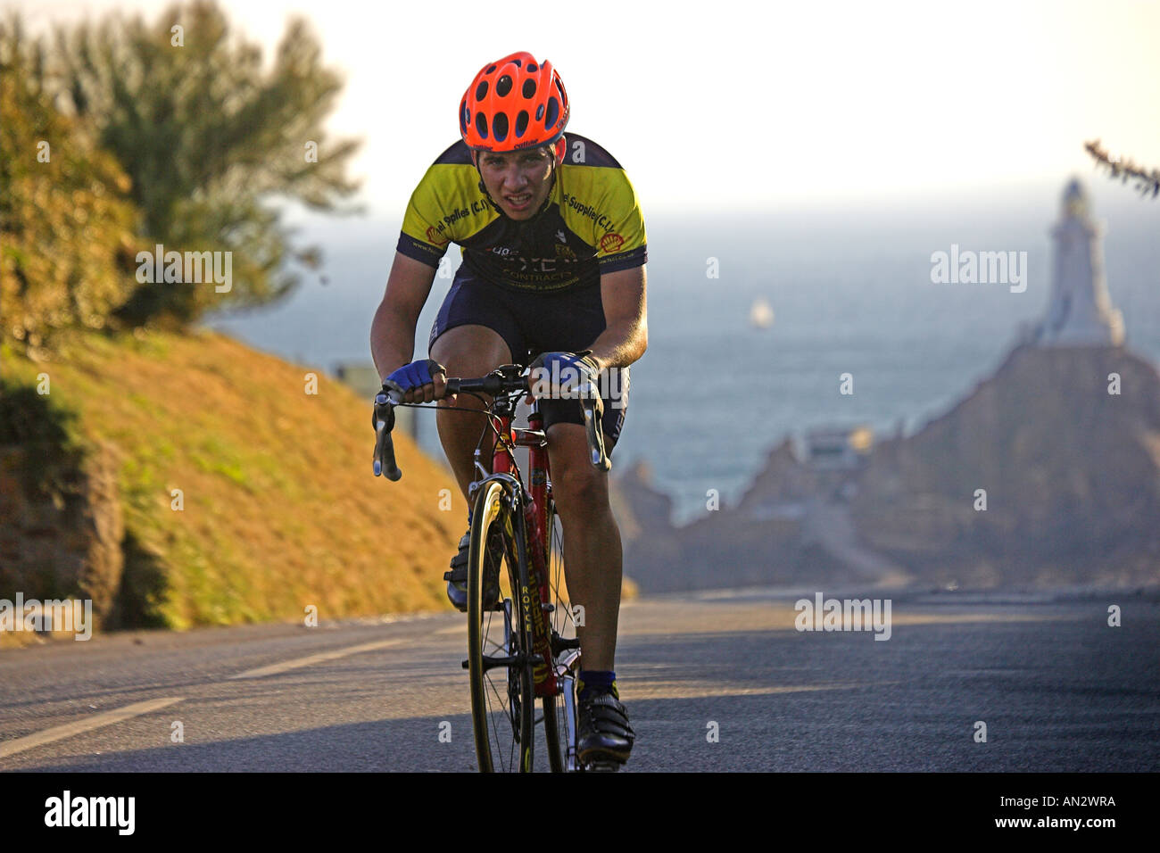 Great Britain UK GB Road Race Corbiere  With Corbiere Lighthouse   in the background - Stock Image
