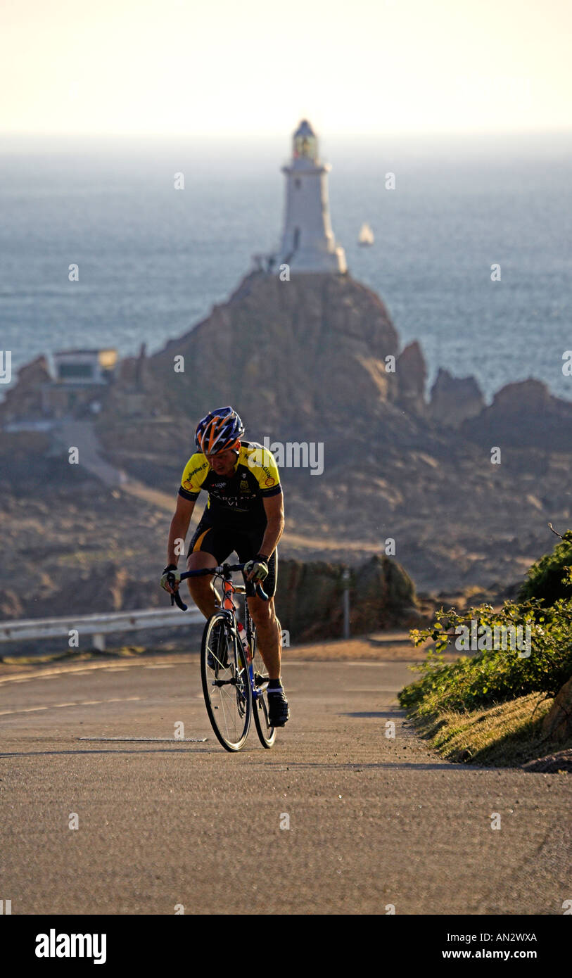 Jersey ,Channel Islands UK Great Britain UK GB Road Race Corbiere  With Corbiere  in the Lighthouse background - Stock Image