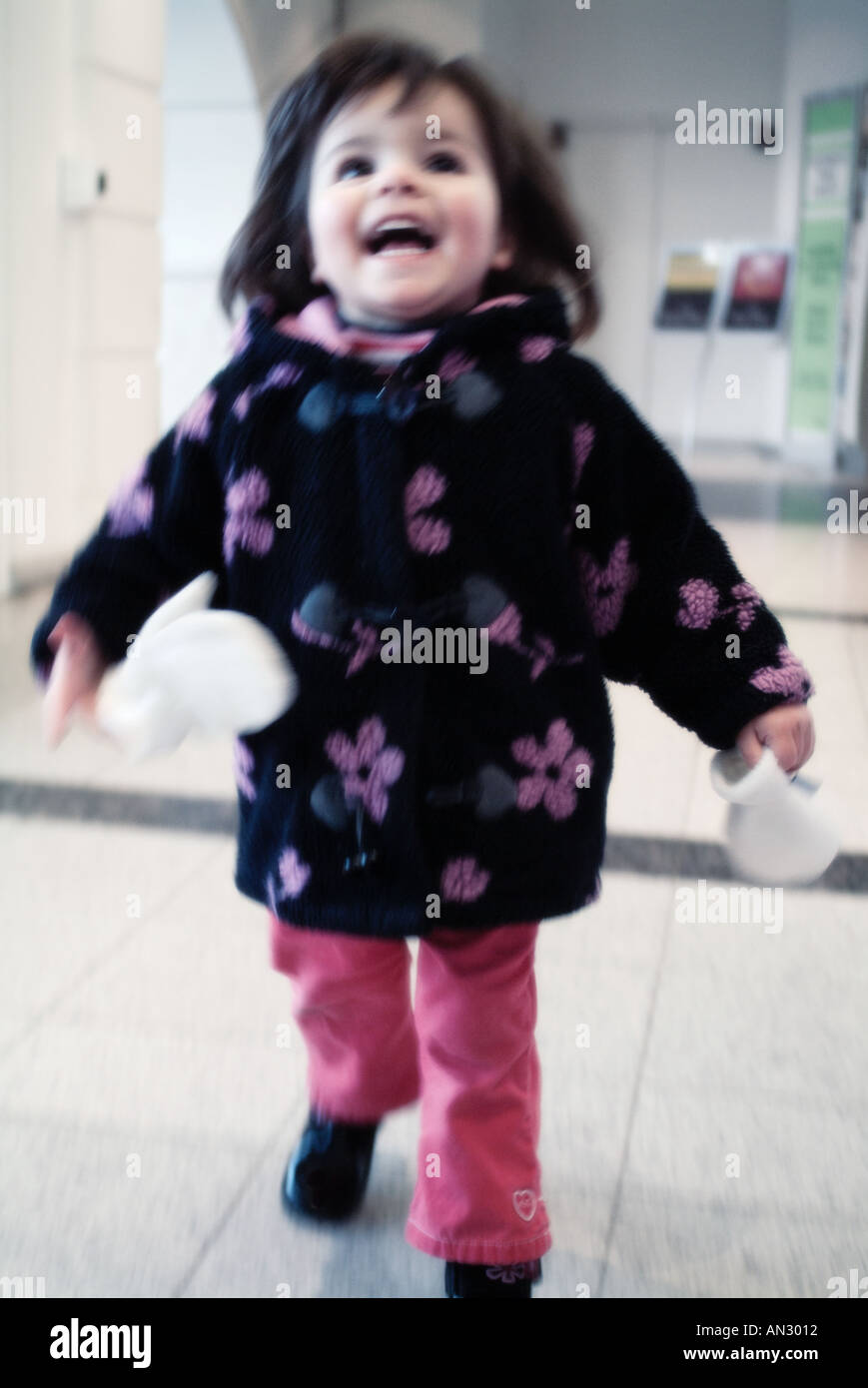 running child in a shopping mall London england - Stock Image
