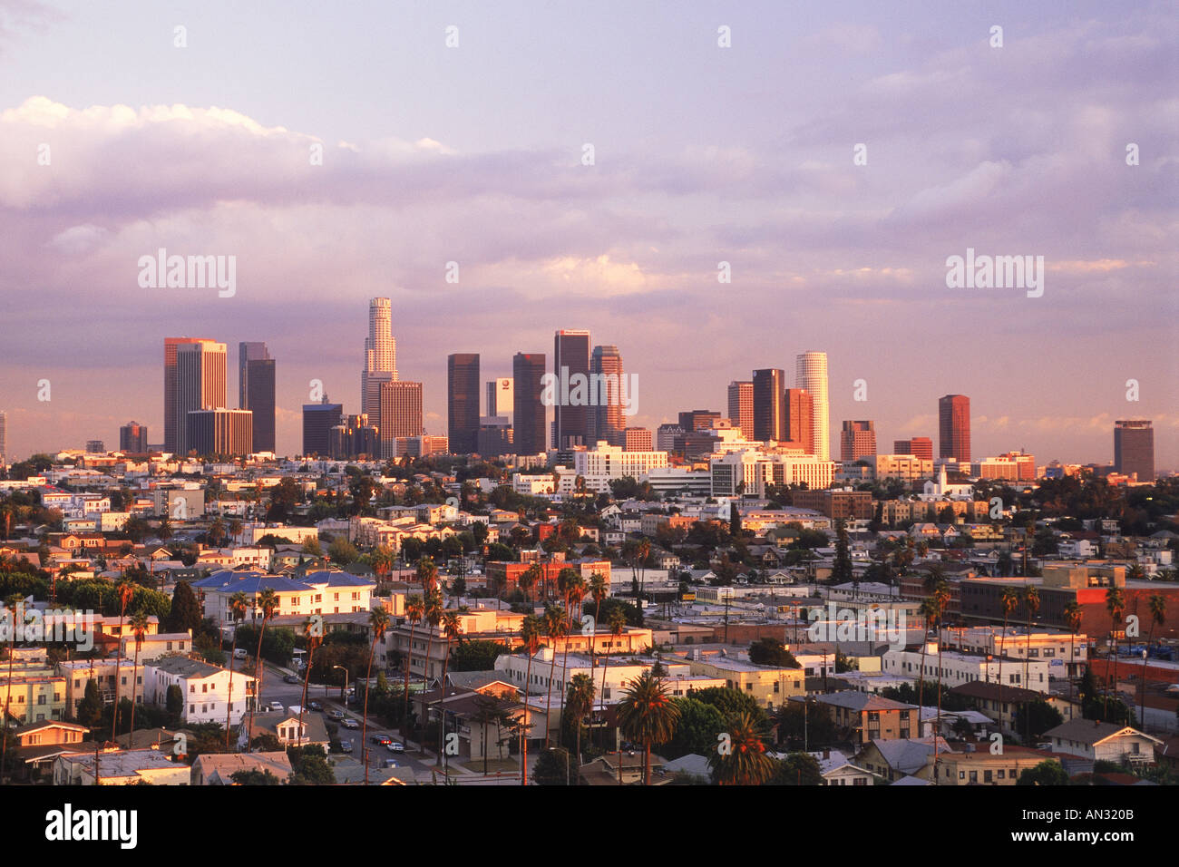 Overview of East Los Angeles suburbs with downtown Civic Center above the urban sprawl at sunset - Stock Image