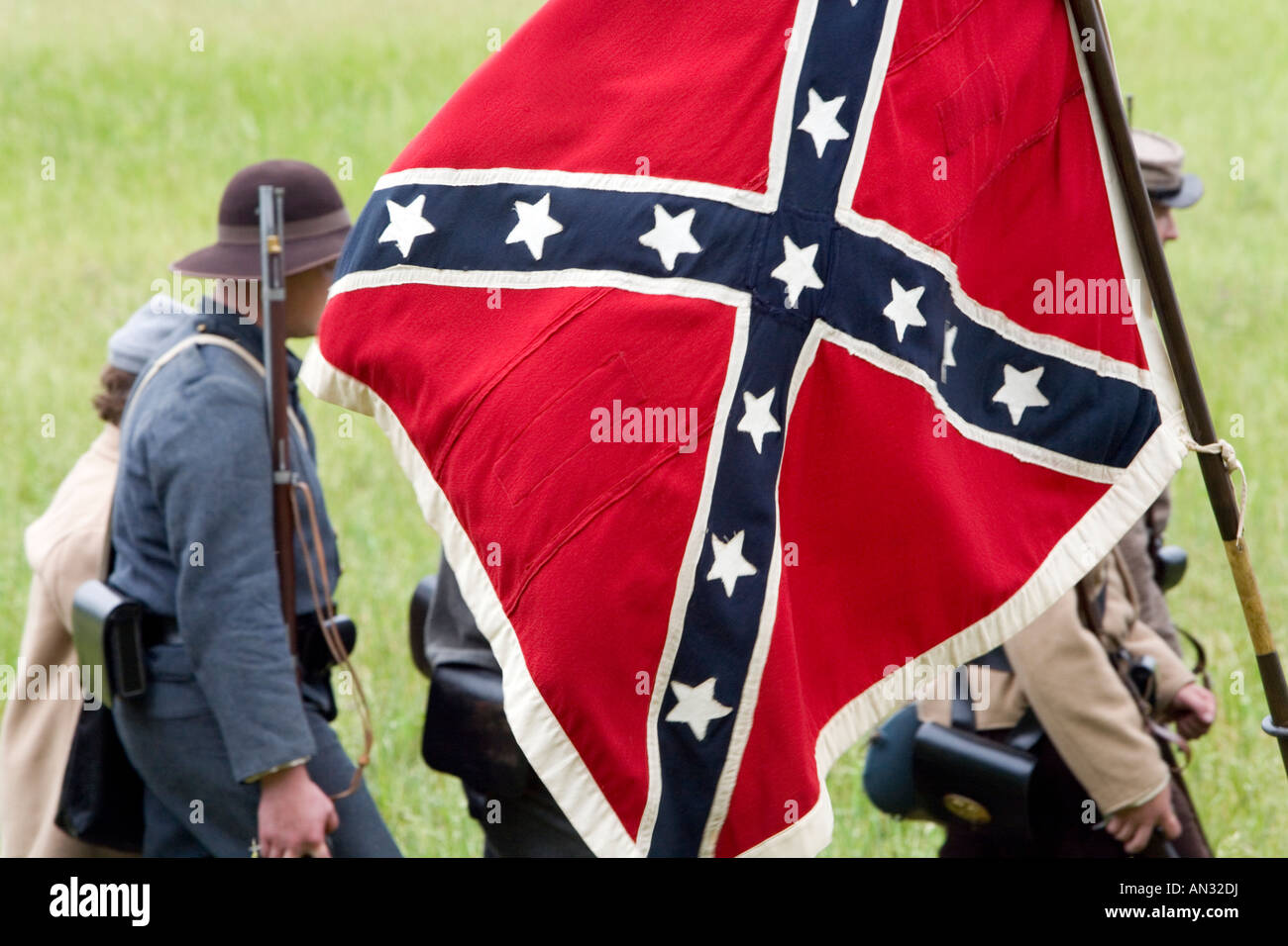A group of American Civil War Reanactors carrying a Confederate Flag on the Gettysburg Field of Battle - Stock Image