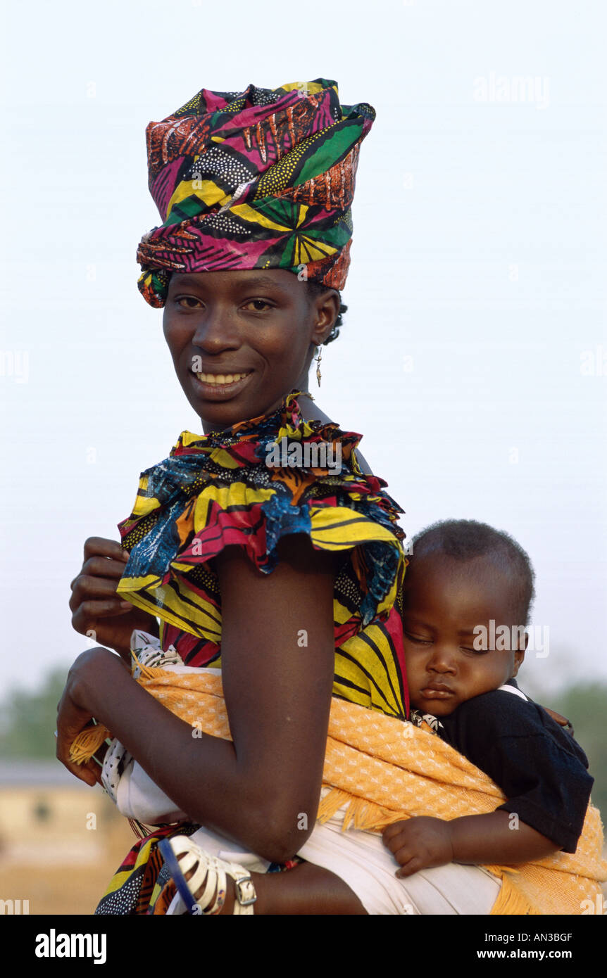African Woman Carrying Baby On Back Stock Photos & African