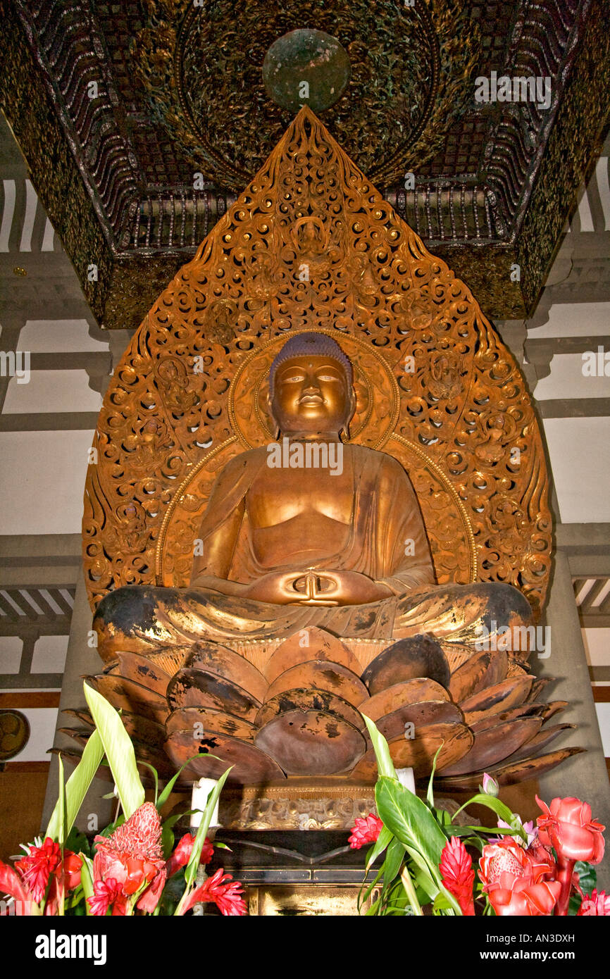Buddha statue at Byodo In Temple reproduction of 900 year old Japanese temple built in 1968 Valley of the Temples - Stock Image