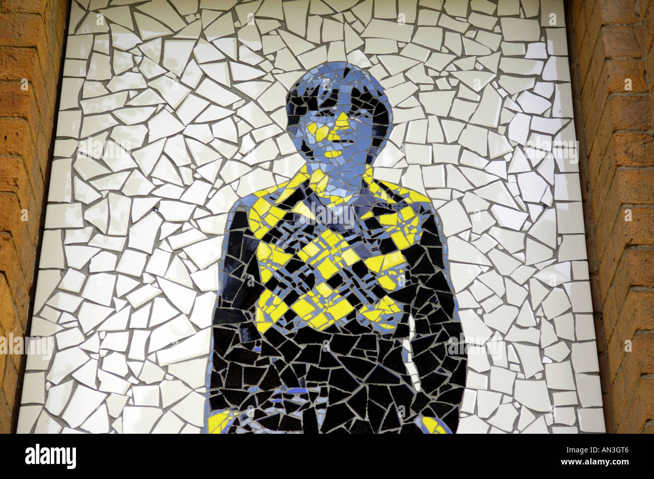 mark e smith the fall legend rocker singer groups band alternative yellow male  man white black tiles wall biblical reference pu - Stock Image