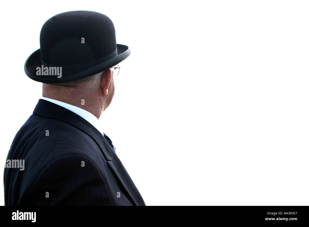 A man wearing a Bowler hat looking away. - Stock Image