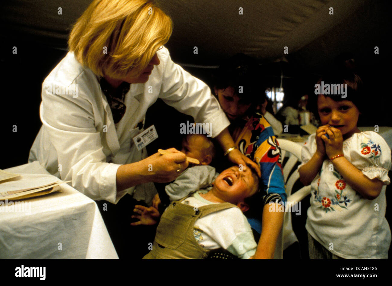 Kosovar children getting medical checkups at a refugee camp in Macedonia during the Kosovo Conflict 1999 - Stock Image
