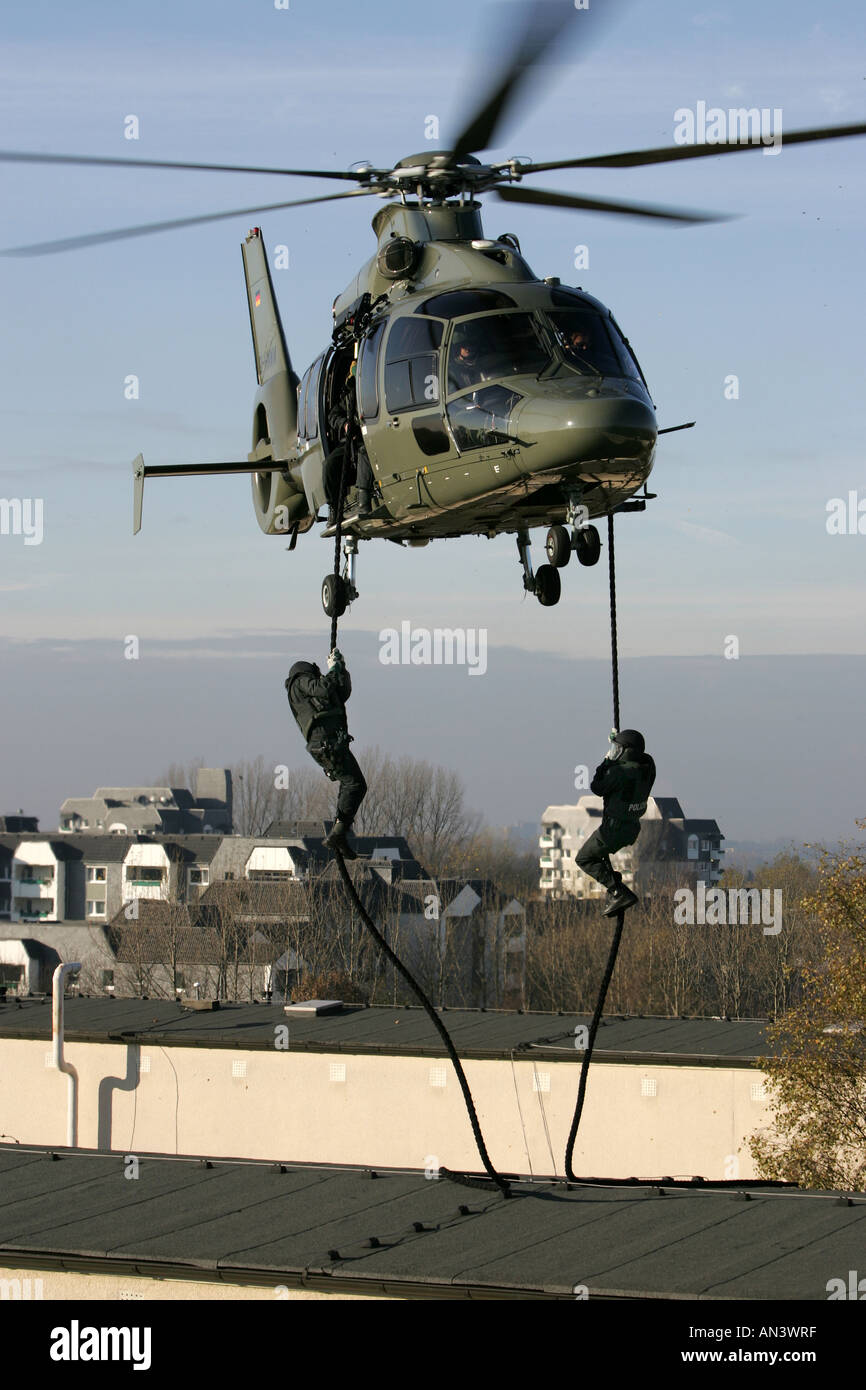 O SWAT team of German Police special forces at a abseiling exercise,  training from a EC 155 helicopter Stock Photo