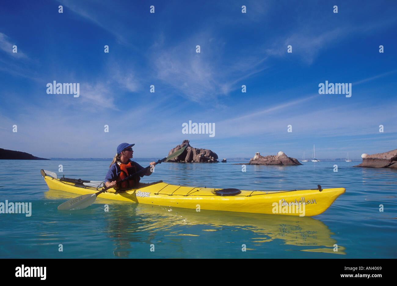 Baja California Sur Mexico woman sea kayaking in the Sea of Cortez at Espiritu Santo Island near La Paz - Stock Image
