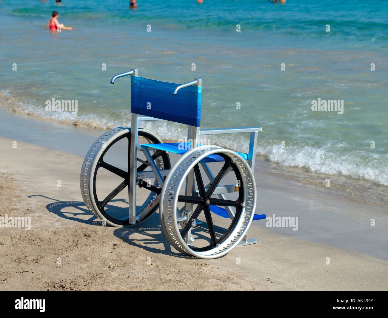 Wheelchair For Disabled Holiday Makers - Stock Image