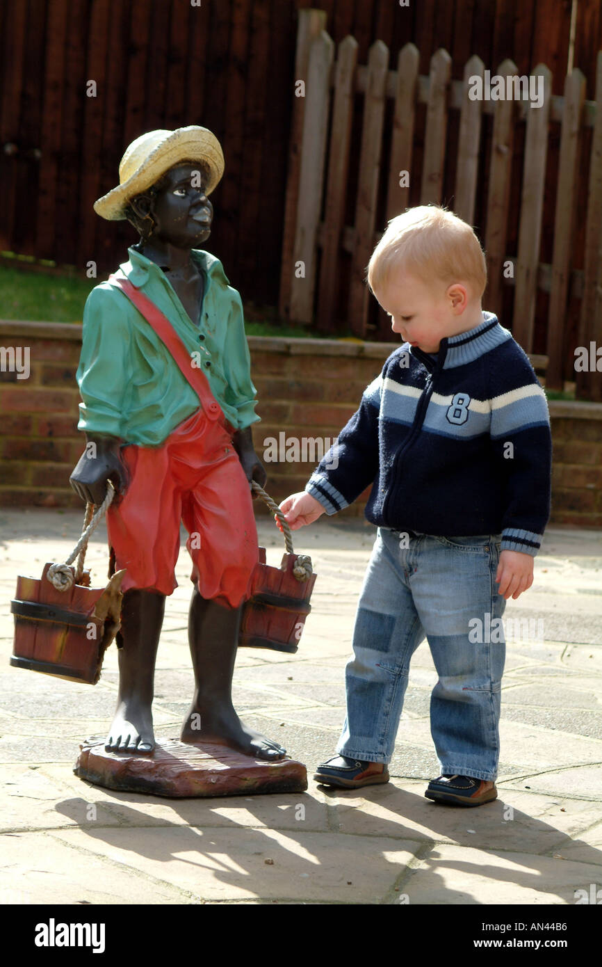 Little Boy With Model Black Child In Straw Hat Holding A Bucket Stock Photo Alamy