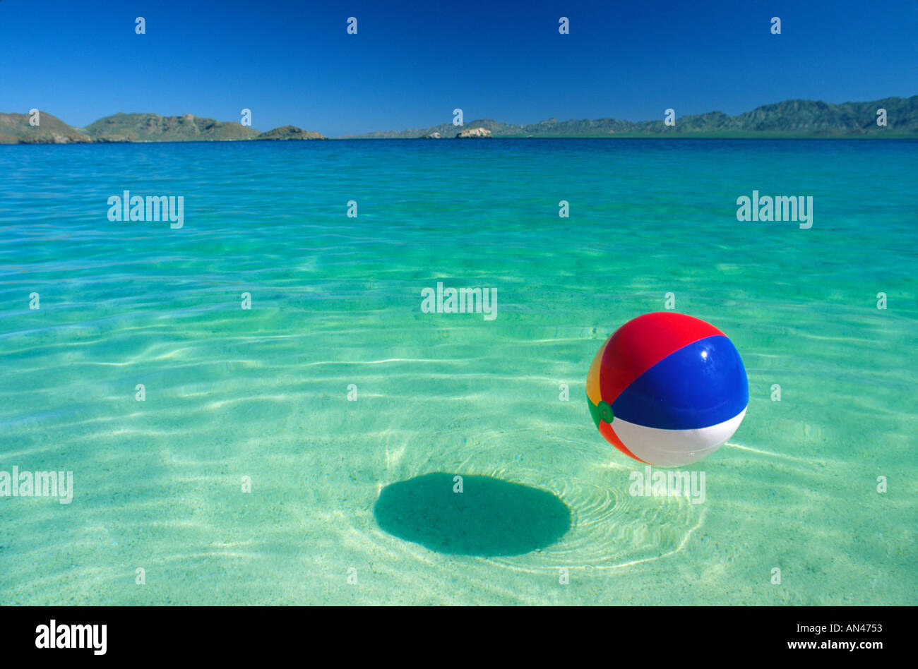 Beach ball in ocean Sand Beach Ball Floating In Tropical Water Alamy Beach Ball Floating In Tropical Water Stock Photo 1394514 Alamy
