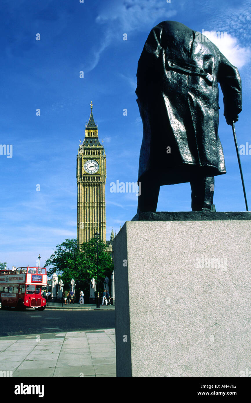Winston Churchill statue Houses of Parliament Big Ben and Routemaster red bus Westminster London England - Stock Image