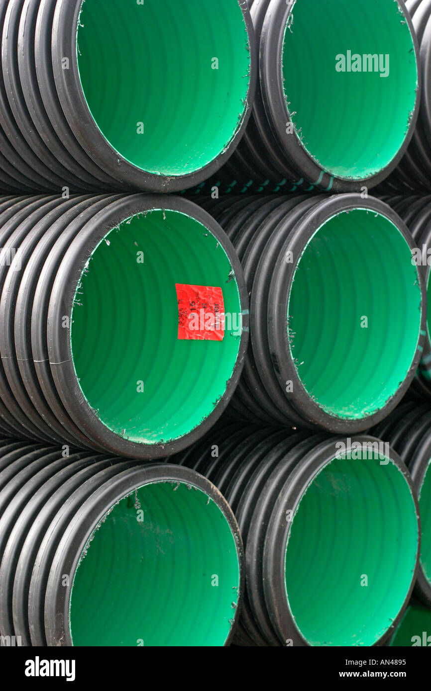 Inventory of PVC drainage pipes / culverts with green interior in stack Stock Photo