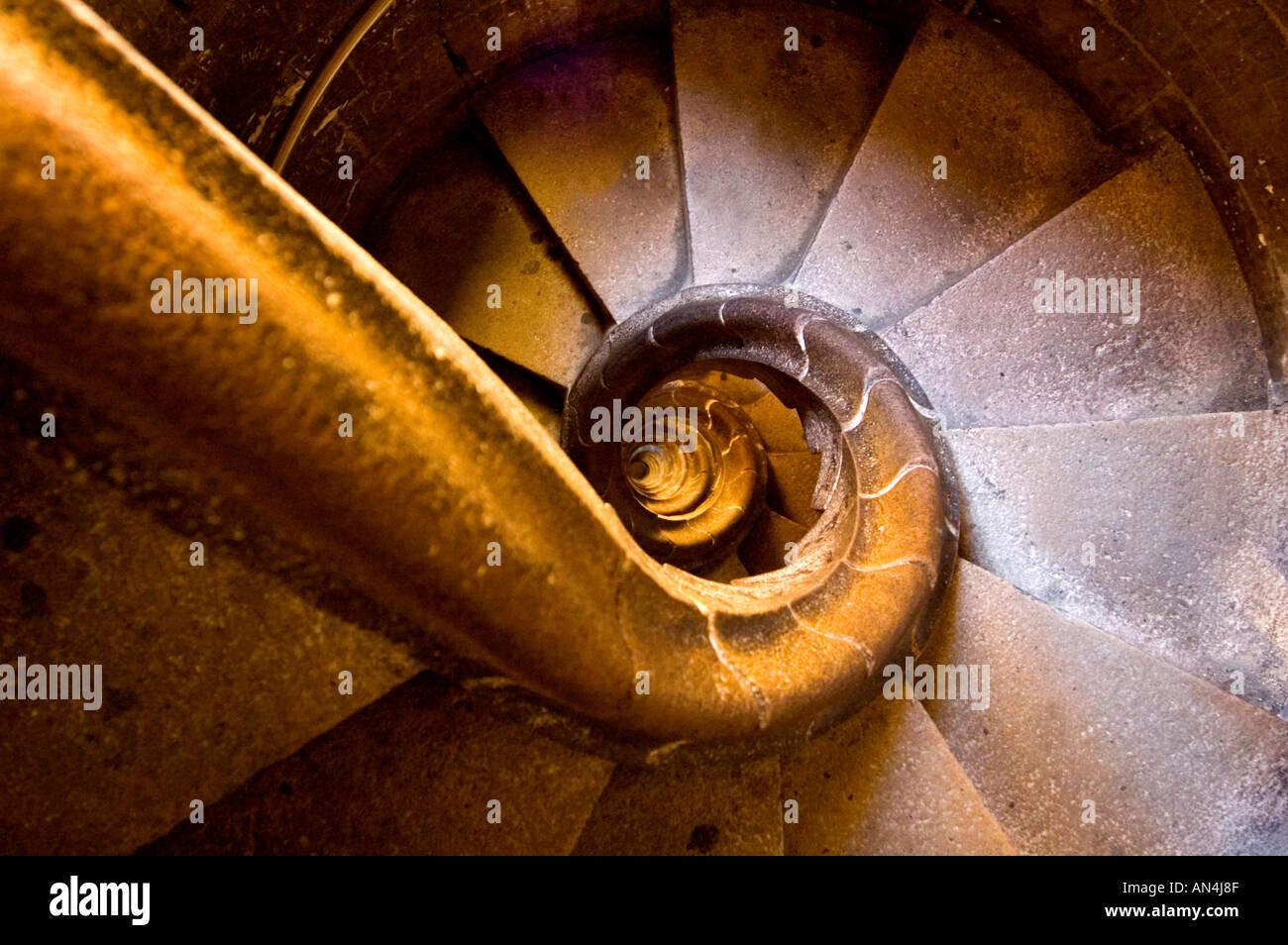 Spiral staircase in Sagrada Família church designed by modernista architect Antoni Gaudí Barcelona Spain - Stock Image