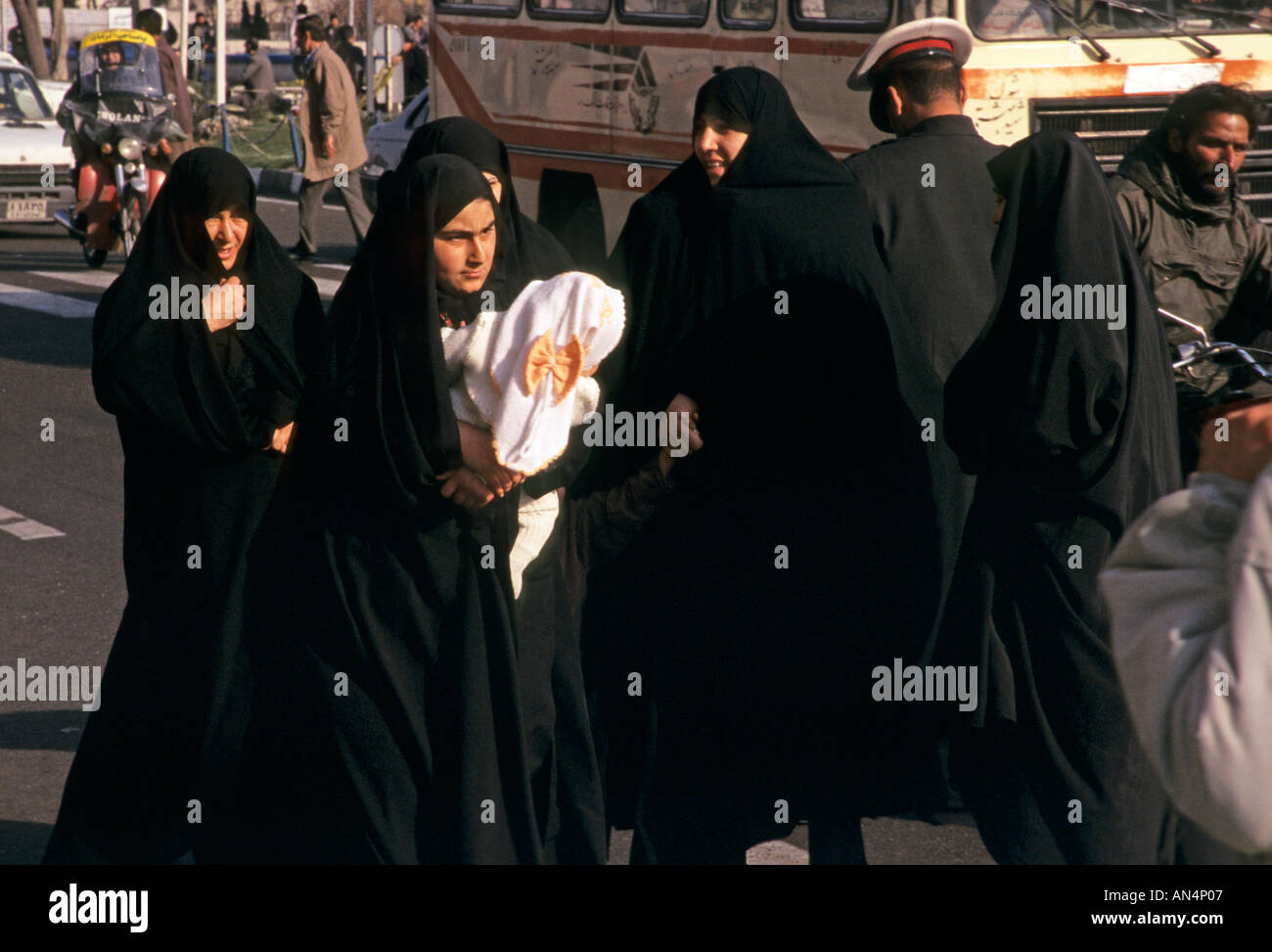Women wearing burqas on a sreet in Tehran Iran - Stock Image