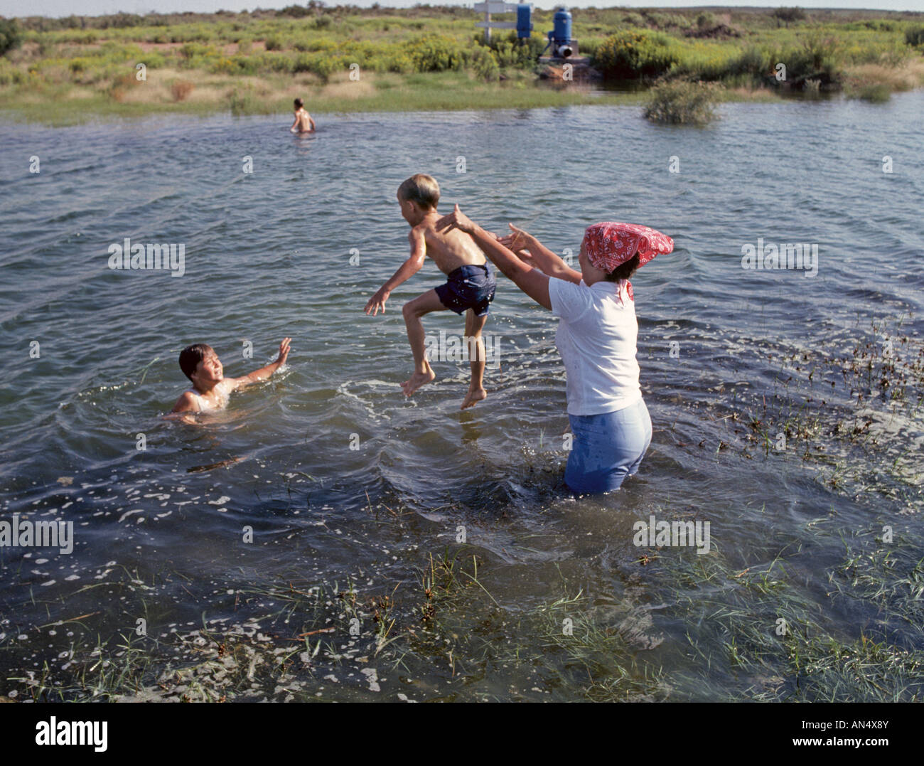 A Farm Wife And Her Children Spend A Hot Summer Day Swimming In A Stock Photo Alamy