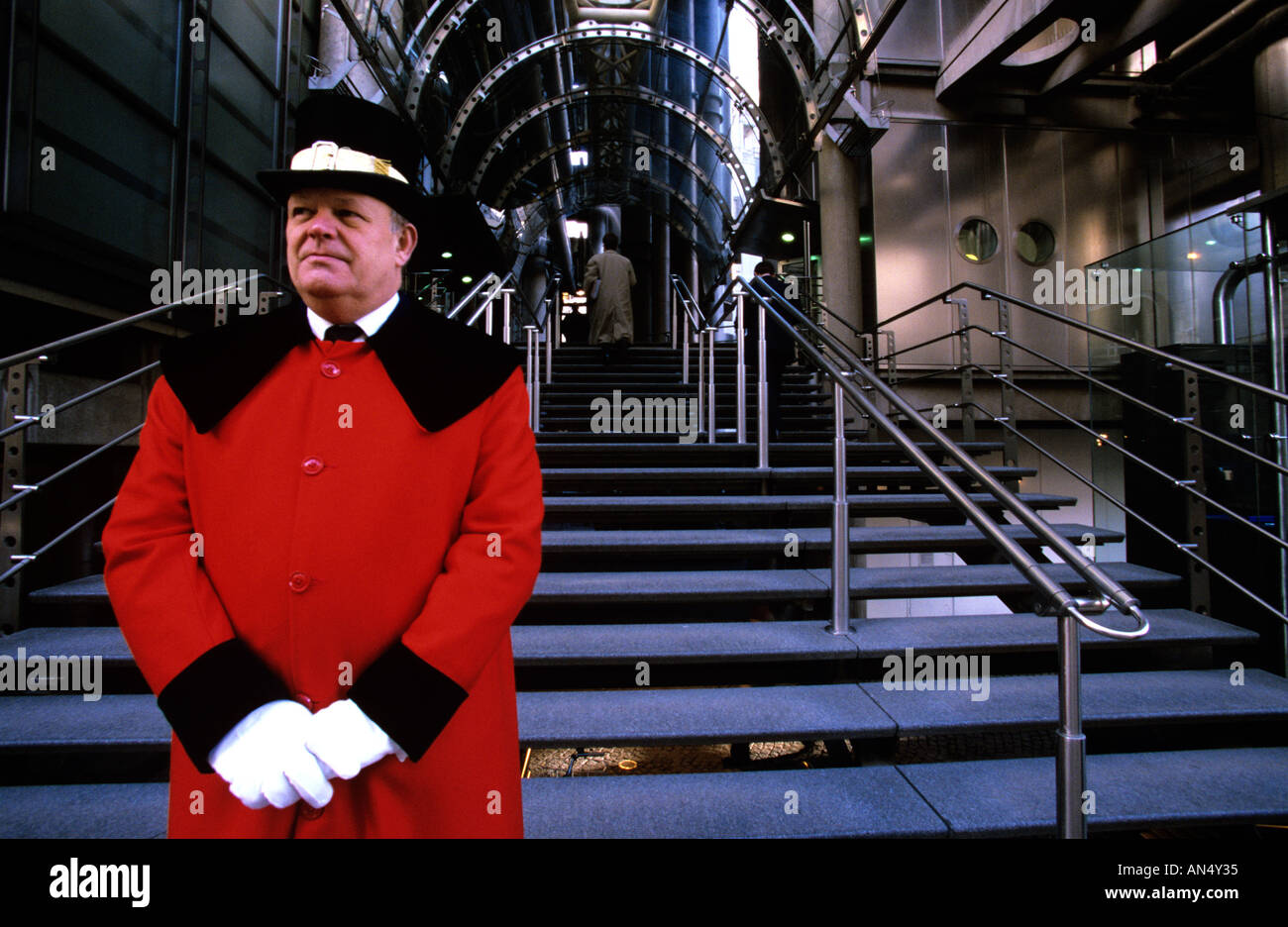 A door man guards at the entrance of Lloyds building London Stock Photo