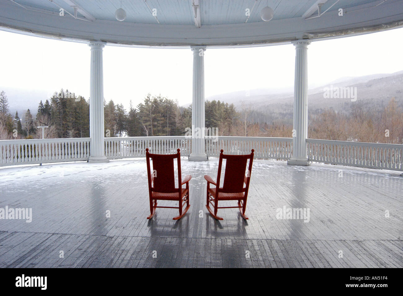 Two empty rocking chairs on the veranda of the Mount Washington Hotel New H&shire & Two empty rocking chairs on the veranda of the Mount Washington ...