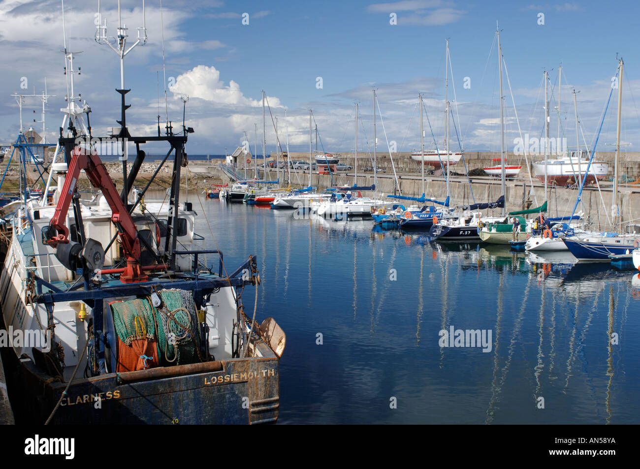 Lossiemouth harbour shared by both fishing and pleasure boats. Morayshire. Scotland.  XPL 3222-321 - Stock Image