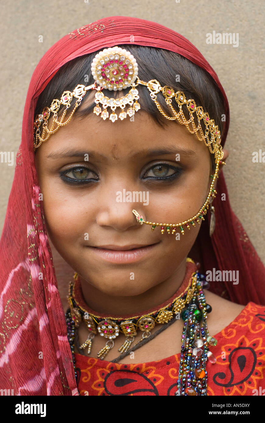 portrait of a smiling gypsy girl from rajasthan india stock photo
