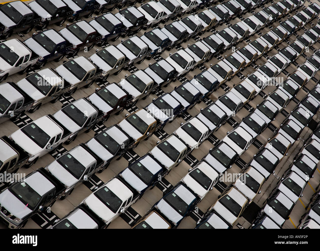 Graphic shot of cars at car port at PSA Shipping and containerisation Port of Singapore - Stock Image