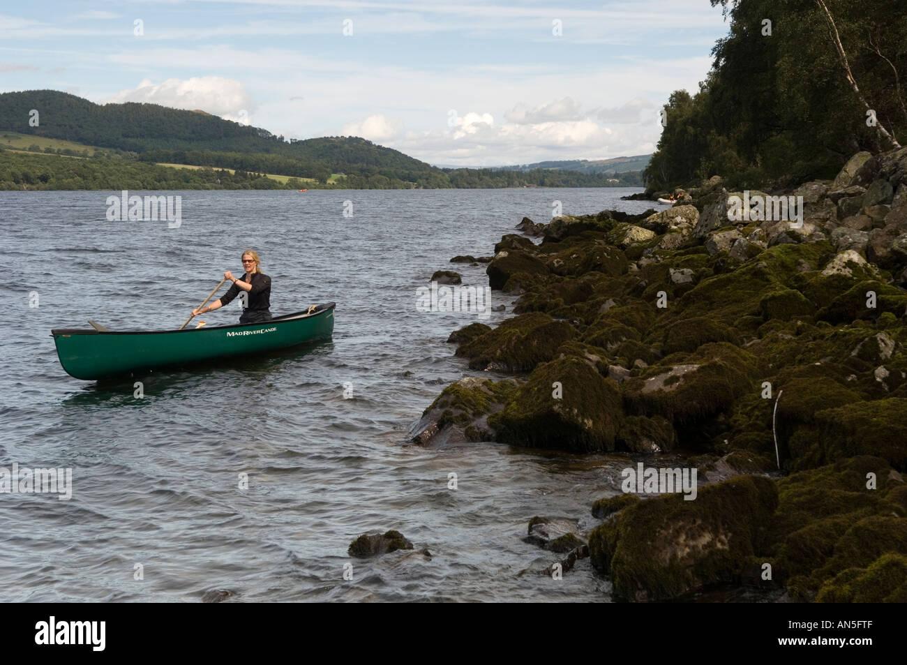 Diane Alger paddling a Mad River Canoe Explorer 16 on